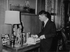 Robert F. Kennedy in room.