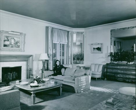 A friendly atmosphere... enhanced by tasteful and harmonious color tones, distinguishes the living room of Rosalind Russell's Beverly Hills home.