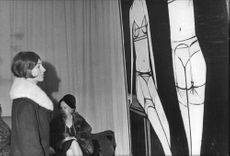 Woman looking at Bernard Buffet painting.