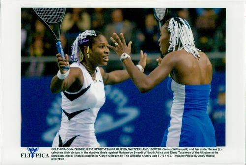 Serena Williams (television) and sister Venus are about to hug each other after the double win at the European Indoor Championship.