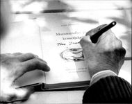 "Writer Tove Jansson signs his book ""Mumintrollet og kometjakten"""