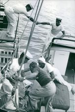 Stavros Niarchos on a boat with his crew.