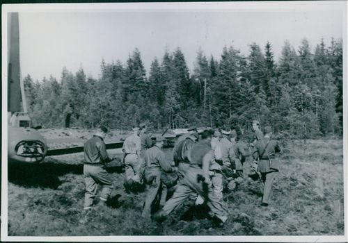 Soldiers landed from an airplane and walking in the forest. 1943