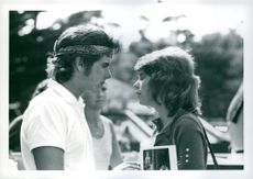 Desi Arnaz, Jr. and Kim Darby chat together after lunch at a sunset strip restaurant. Desi came off the tennis court to meet Kim for the date.