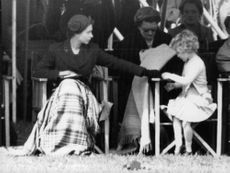 Queen Elizabeth II and her daughter Princess Anne sitting beside each other in an event.  - 1955