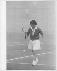 Princess Michiko of Japan playing tennis.