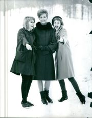 """Jane Axell, Christina Granberg and Monica Ekman posing at the snow in the scene of the movie, """"Venusberg""""."""