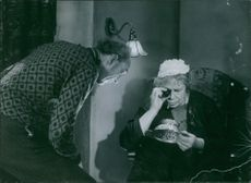 A scene from the film While the City Sleeps. 1950