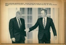 George Walker Bush with Elect Clinton.