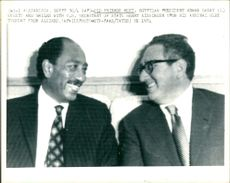 Dr. Henry Kissinger with Mr sadat.