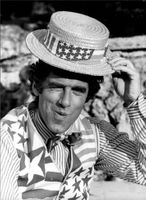 "The American actor Elliott Gould photographed under a scene in the movie ""Escape to Athena"" where he plays the entertainer Charlie."
