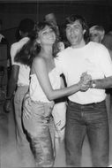 The tennis player Ilie Nastase is dancing with a woman at the nightclub Xenon in New York