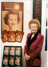 Margaret Thatcher poses with his books