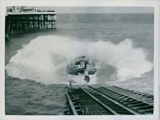 British lifeboat goes down the slipway from its shed into the open sea.  Taken - Circa 1940