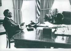 President Gerald Ford of the United States listens intently to his secretary of Transportation William Coleman.