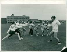 David Knights, a senior pupil at the school, is seen above fencing with a group of younger boys.