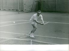 A man is playing Tennis.1963