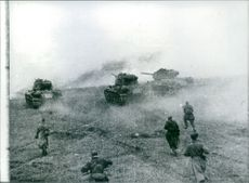 Russian infantry follow tanks into battle against the Germans in the Moscow region in late 1941.
