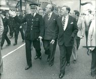 Viscount William Whitelaw and Constable David McNee touring Brixton