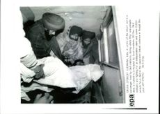 A Victim of the shoot out in a passenger train.