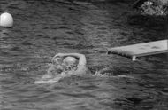 Yul Brynner swimming.