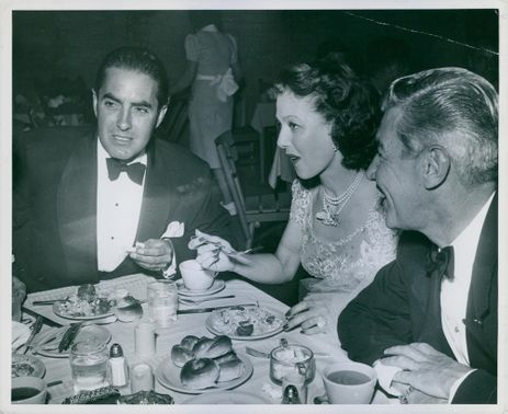 Ty Power dining with Loretta Young and husband, Tom Lewis.