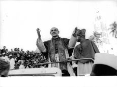 Pope Paul VI smiling.