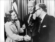 Betty Ford congratulates former New York governor Nelson Rockefeller to the post as vice president. President Gerald Ford in the middle