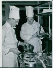 Two restaurant personal cooks preparing a dish at Solliden in 1952.