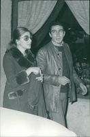 Princess Soraya walking with a man.