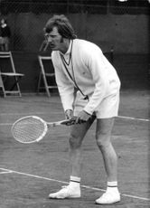 John Paish playing tennis.