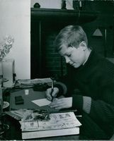 Carl XVI Gustaf of Sweden as a child, doing homework.