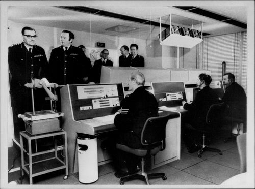 Scotland Yard interior with police at information centers