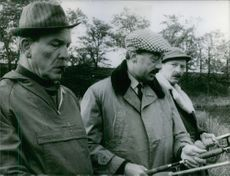 Men fishing with fishing road. 1966
