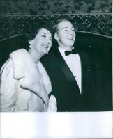 Portrait of Rosalind Russell with a man.