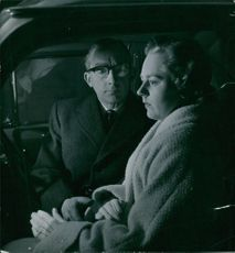 A man and a woman inside the car.