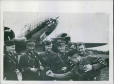 The commander of a Russian bomber telling his comrades, with explanatory gestures, about a raid carried out on an enemy aerodrome, 1942.