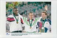 The prizes of men 1500 m Stephen Kipkoir, Noreddine Morceli and Fermin Cacho with their medals during the Olympic Games in Atlanta 1996