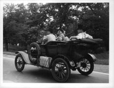 People travelling in Ford Model T.