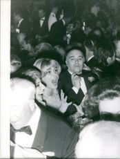 Melina Mercouri, in the middle of a crowded place. December 11, 1961.