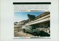 The 1994 Northridge earthquake USA: the front end of a car is buried.