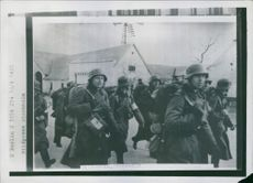 German military men marching along the streets of Denmark.