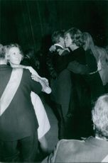 American politician Sargent Shriver and his wife Eunice K. Shriver being photographed while dancing together in a party