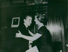 A young Jules Régis Debray congratulates by a woman.