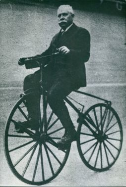 AN OLD MAN RIDING CYCLE
