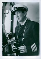 Captain Jacob Jacobson, captain of Israel's first major Trans Atlantic Liner, the SS Jerusalem holding binoculars. The photo was taken during the Eichmann trial.