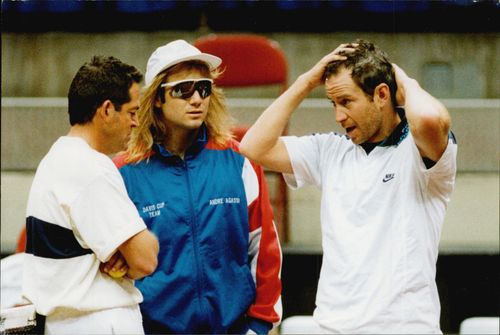 Andre Agassi in concert with John Mc Enroe.