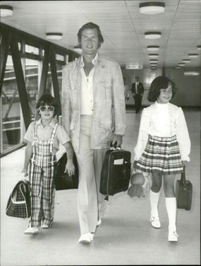 Roger Moore with son Geoffrey and daughter Deborah at Heathrow airport for departure to Rome