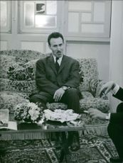 Houari Boumediene sitting on couch.