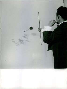 Man using bow and arrow.
